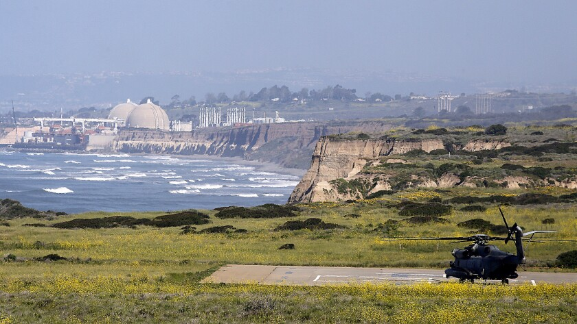 A military helicopter prepares to take off over the coast from Camp Pendleton, located south of the