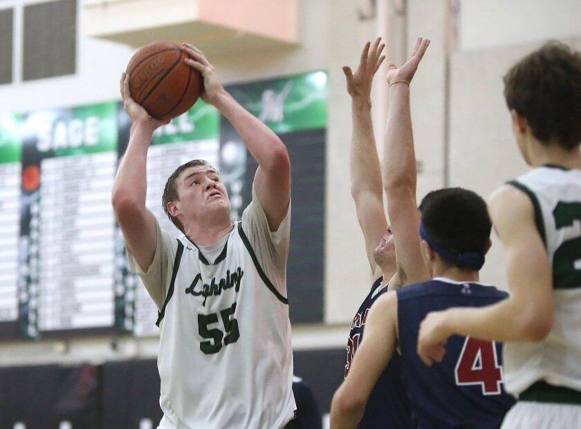 Sage Hill's Johnny King turns and shoots a short jumper in the Academy League boys' basketball cham