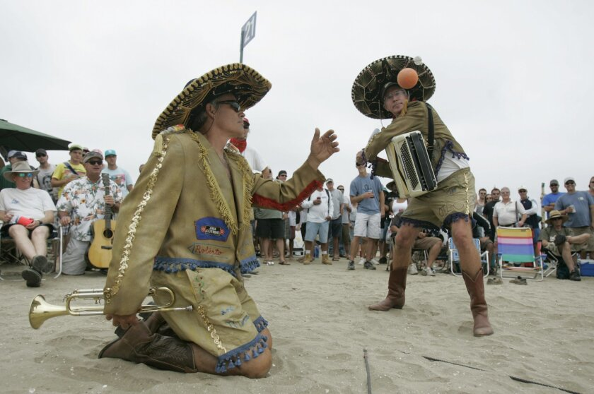 """Bob """"Roberto"""" Ruane pitches to his teammate Dale """"Dalito"""" Olson on Saturday. Los Mariachis credit their cowboy boots for some of their Over-The-Line success."""