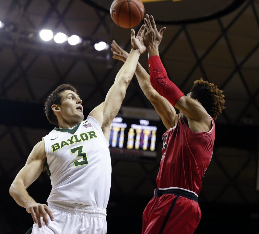 Texas Tech forward Justin Gray, right, is pressured by Baylor guard Jake Lindsey in the first half of an NCAA college basketball game, Saturday, Feb. 13, 2016, in Waco, Texas. (AP Photo/Rod Aydelotte)