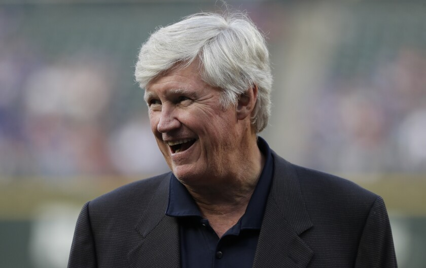 Seattle Mariners owner John Stanton stands on the field.