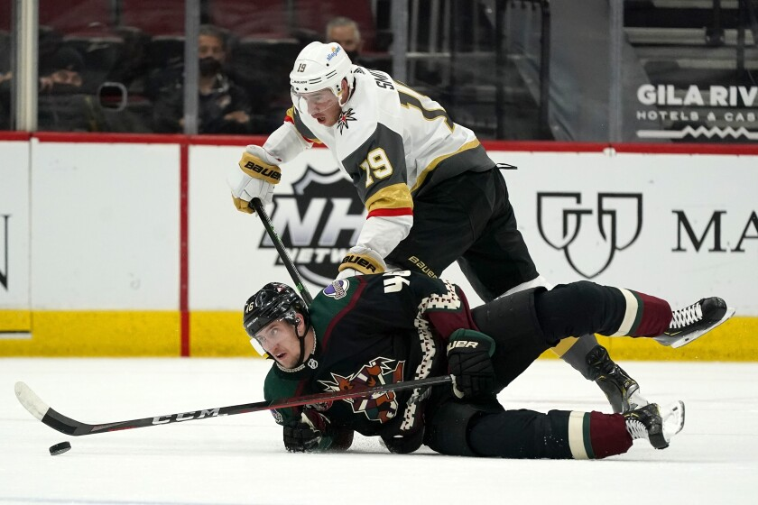 Vegas Golden Knights right wing Reilly Smith (19) sends Arizona Coyotes defenseman Ilya Lyubushkin (46) to the ice during the first period of an NHL hockey game Friday, April 30, 2021, in Glendale, Ariz. (AP Photo/Ross D. Franklin)