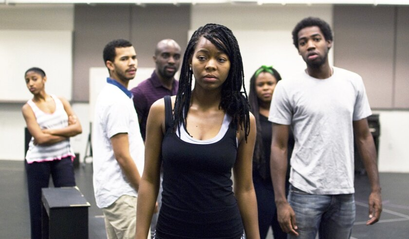 """Chaz Hodges (center) stars as the track phenom Oya, alongside (left to right) Jasmine St. Clair, Gerard Joseph, Toby Onwumere, Tesiana Elie and Maurice Williams, in the UCSD production of Tarell Alvin McCraney's """"In the Red and Brown Water."""""""