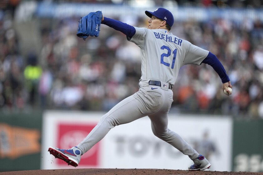 Los Angeles Dodgers starting pitcher Walker Buehler winds up during the first inning of the team's baseball game against the San Francisco Giants on Wednesday, July 28, 2021, in San Francisco. (AP Photo/Tony Avelar)