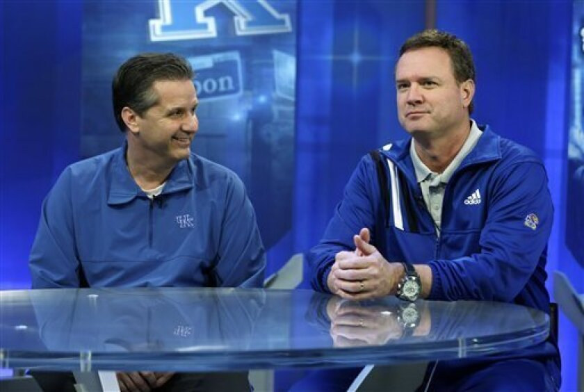 Kentucky head coach John Calipari talks with Kansas head coach Bill Self, right, during a television interview at the NCAA Final Four college basketball tournament Sunday, April 1, 2012, in New Orleans. (AP Photo/David J. Phillip)