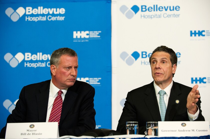 NEW YORK, NY - OCTOBER 23: Mayor Bill DeBlasio of New York City and Governor Andrew Cuomo of New York speak at a press conference October 23, 2014 in New York City.