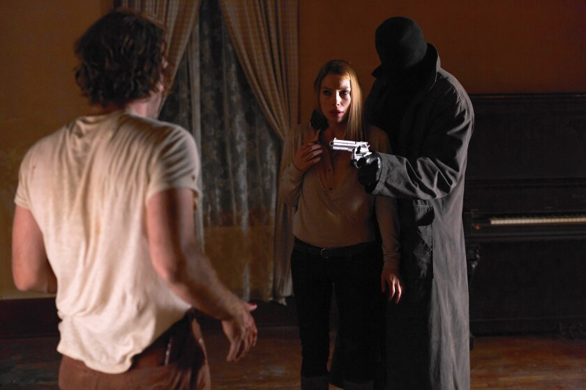 """A suicidal Thomas Jane, left, Joanna Douglas and hit man Laurence Fishburne star in """"Standoff."""""""