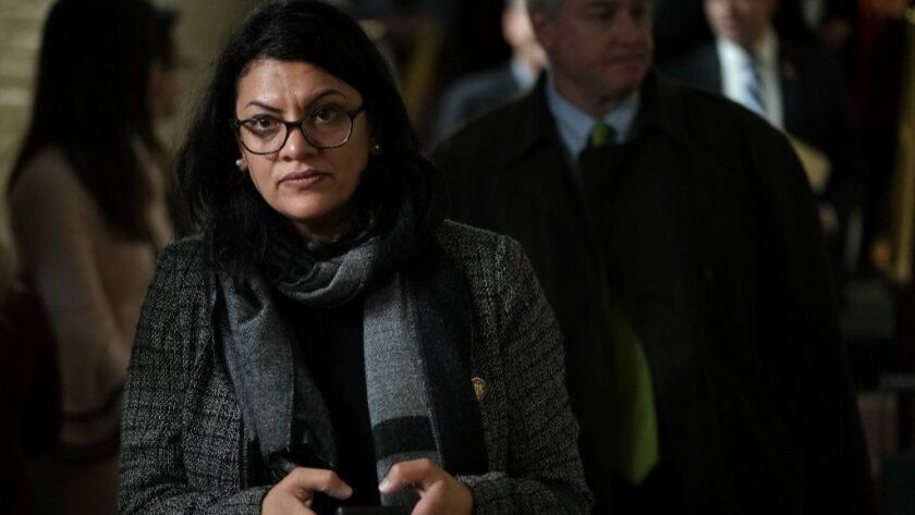 Rep. Rashida Tlaib leaves after a caucus meeting at the U.S. Capitol on Jan. 9.