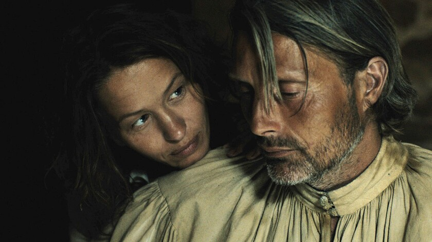 "Mads Mikkelsen as Michael Kohlhaas and Delphine Chuillot as Judith in ""Age of Uprising: The Legend of Michael Kohlhaas."""