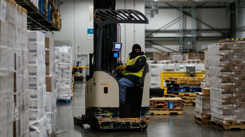 VERNON, CALIF. - JUNE 25: Workers move and store inventory at Lineage Logistics at on Tuesday, June