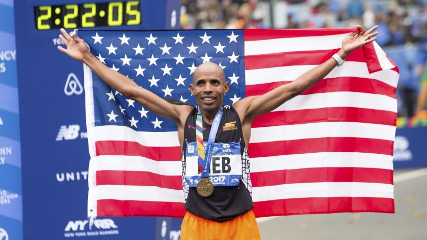 Meb Keflezighi finished 11th in the men's 2017 New York City Marathon on Nov. 5, 2017. It marked the 26th and final marathon for the runner, 42. San Diego friends and fans gave him a surprise race retirement party at Liberty Station on Nov. 13 after he flew home from New York.