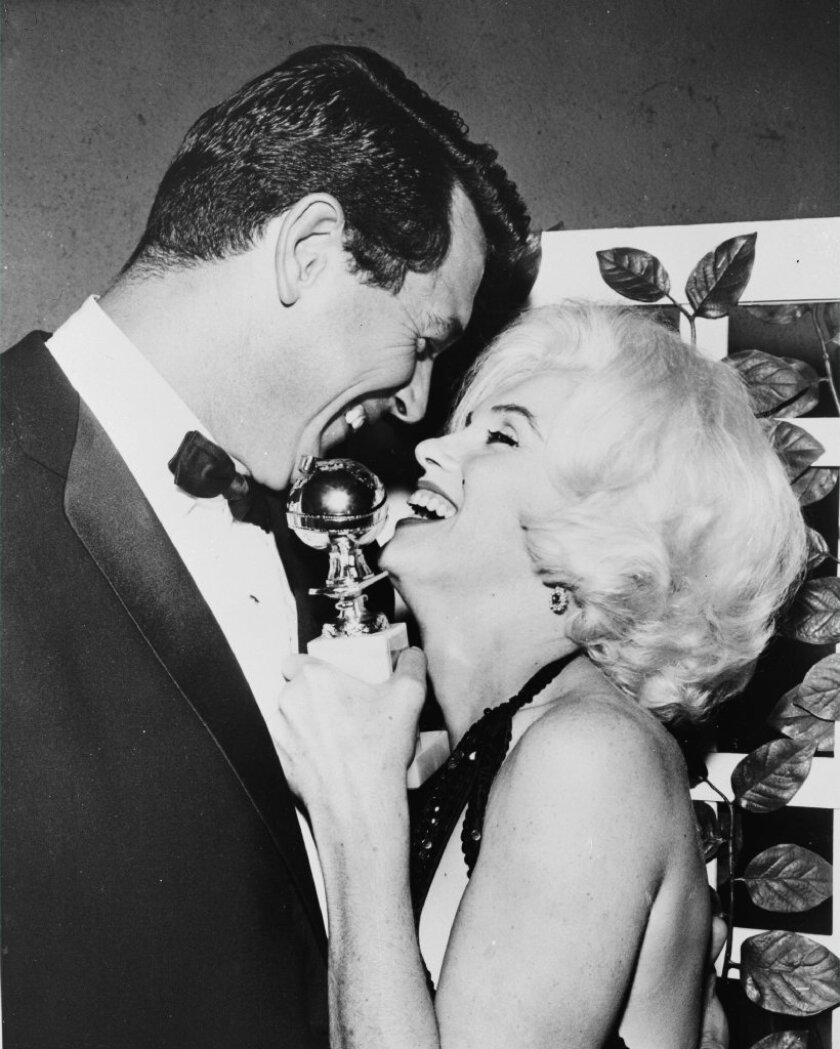 Marilyn Monroe receives her Golden Globe award from Rock Hudson at the Beverly Hilton in 1962.