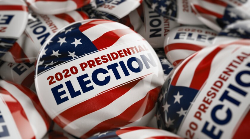 Closeup shot of one presidential election button in focus in bet