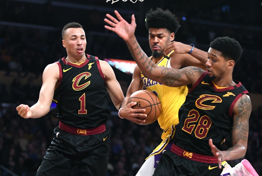 Lakers' Quinn Cook grabs a rebound from Cleveland Cavaliers' Dante Exum (1) and Alonzo McKinnie in the third quarter at the Staples Center on Monday.