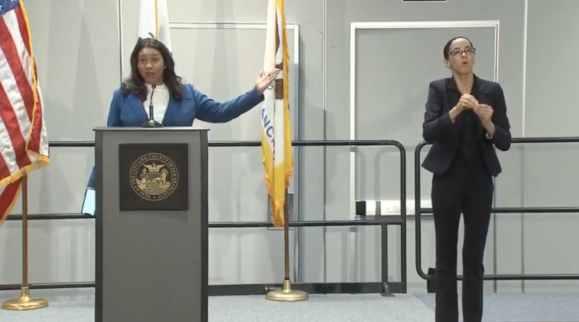 San Francisco Mayor London Breed, left, urges the public to stay home.