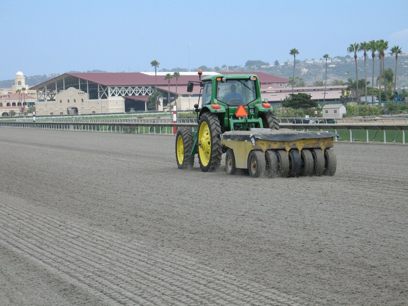 Track superintendent Richard Tedesco's crew put the finishing touches on the Polytrack course Sunday to prepare for today's opening day for training at the Del Mar Racetrack.