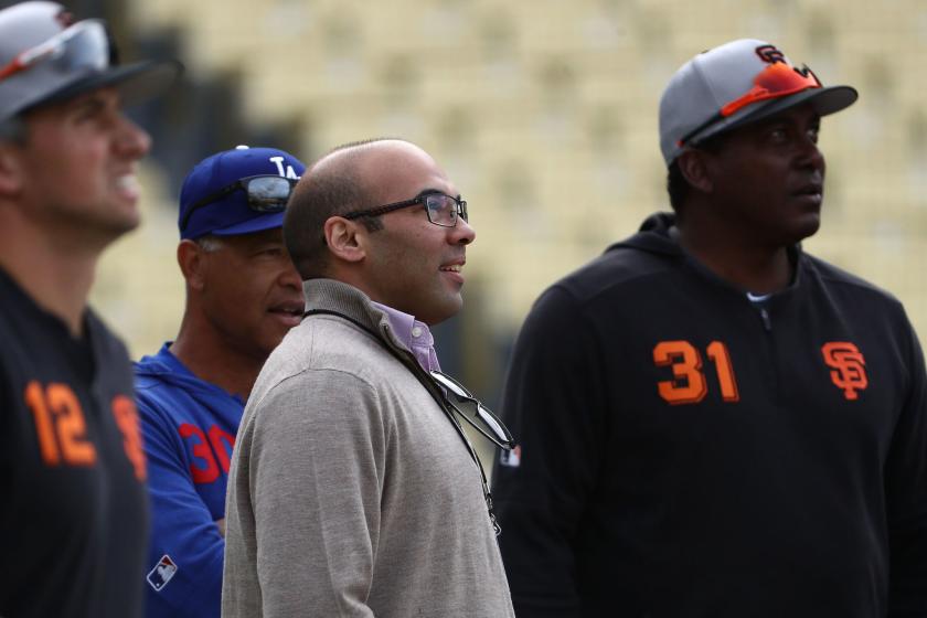 Giants president of baseball operations Farhan Zaidi watches batting practice.