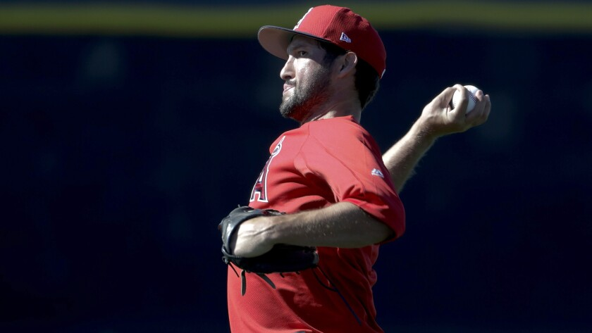 Angels relief pitcher Huston Street loosens up before a spring training workout last month in Tempe, Ariz.