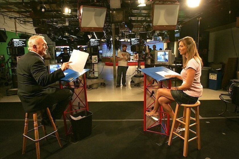"""Sports anchor Paul Rudy (left), headlines the Friday night high school football program """"Prep Pigskin Report"""" along with co-anchor Kerri Sargent on KUSI Chanel 9/51."""