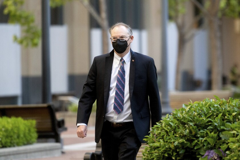 """Epic Games CEO Tim Sweeney enters the Ronald V. Dellums building in Oakland, Calif., on Friday, May 21, 2021. Sweeney said Wednesday, Sept. 22, 2021 it's been told by Apple that the game will be """"blacklisted from the Apple ecosystem"""" until the companies' legal case is resolved and all appeals are exhausted, which could take as long as five years. (AP Photo/Noah Berger)"""