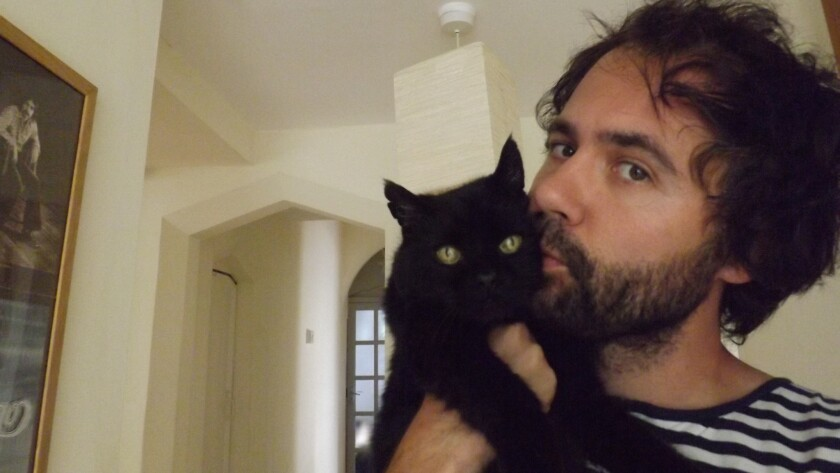 Cox with The Bear, aka @MySadCat with more than 300,000 Twitter followers