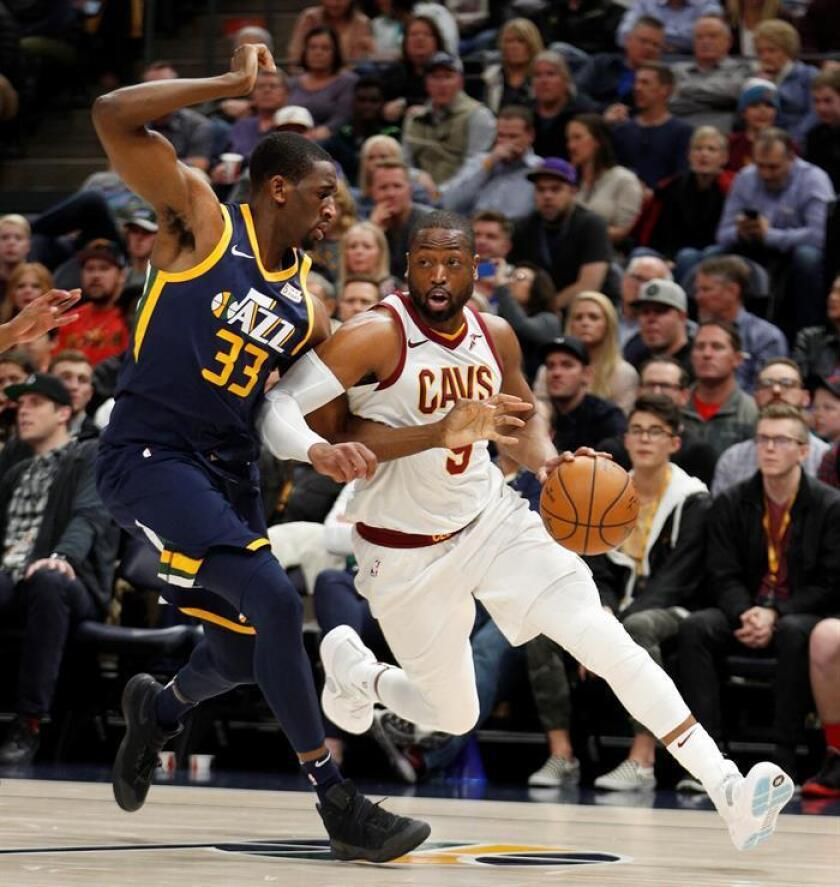 Cleveland Cavaliers guard Dwyane Wade (R) drives past Utah Jazz center Ekpe Udoh (L) during an NBA game at Energy Solutions Arena in Salt Lake City, Utah. EFE