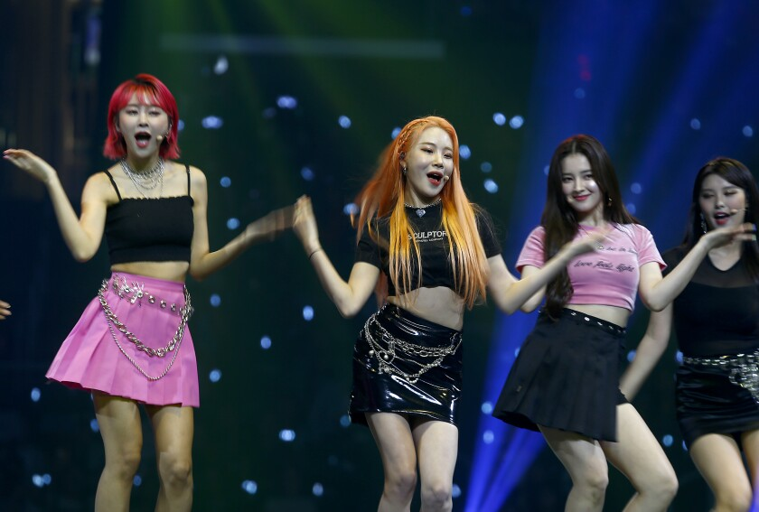 The K-pop girl group Momoland performs at KCON, a huge South Korean pop culture event, at Staples Center in Los Angeles on Saturday.