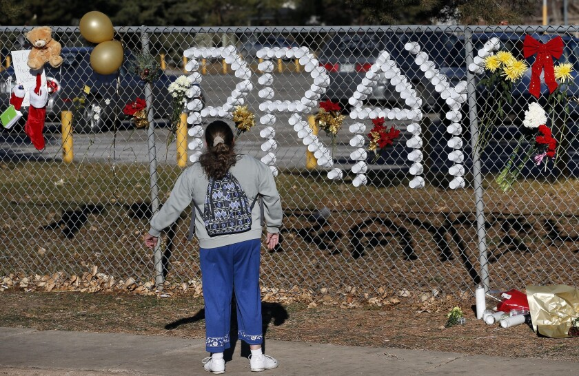 A makeshift memorial continues to attract visitors at Arapahoe High School in Centennial, Colo., after a Dec. 13 shooting. Now two teens have been arrested in an alleged plot to shoot up their high school in Trinidad, Colo.