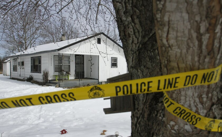 FILE - In this Feb. 27, 2015, file photo, police tape surrounds a crime scene near Tyrone, Mo. A southern Missouri man who fatally shot seven people before killing himself had a blood alcohol level three times the legal limit and marijuana in his system. Texas County Sheriff James Sigman said Wedne