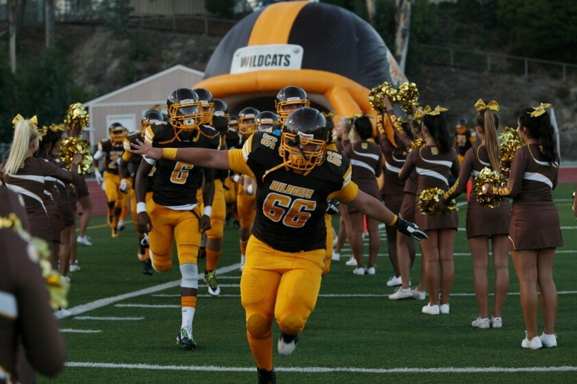 Wildcat center Zack Losack (66) leads the team onto the field Friday night. In the first wave of Friday night lights across the county, El Camino High in Oceanside hosted the Pt. Loma Pointers in a high scoring game with all the excitement of a new season. El Camino has a new coach in John Rob
