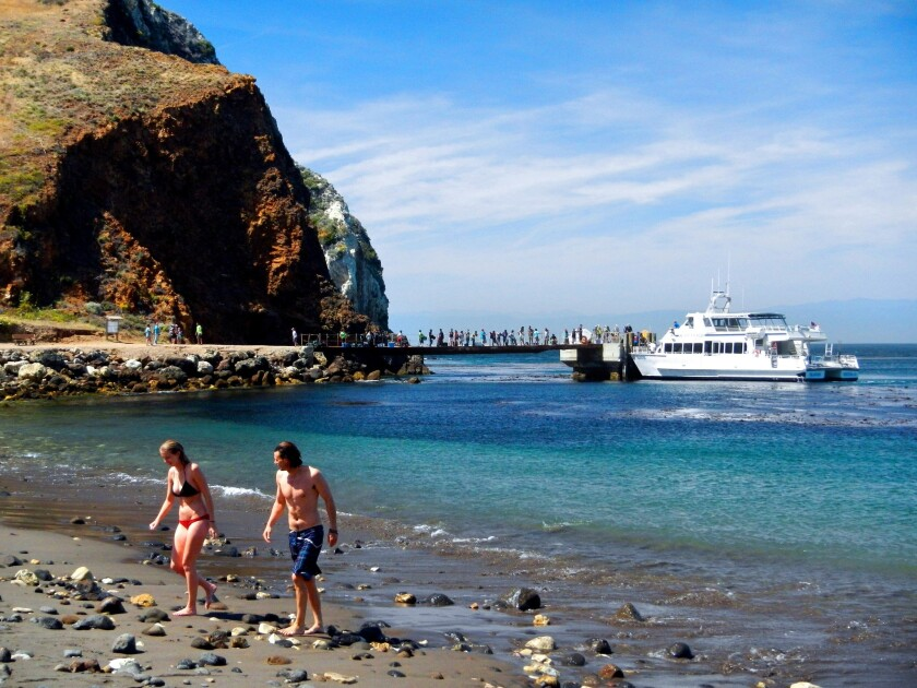 While the Island Packers ferry unloads hikers and campers, swimmers emerge from a brisk dip in Scorpion Anchorage.