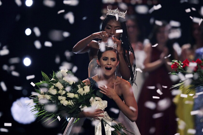 Camille Schrier of Virginia basks in the spotlight after winning the Miss America competition in Uncasville, Conn., on Thursday.