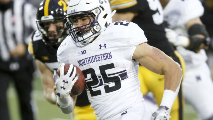 Northwestern running back Isaiah Bowser breaks away on a touchdown run in the second half of the Wildcats' game earlier this season against Iowa.