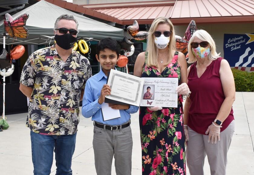 Principal Sal Embry, fifth grader Aadi Bhat, fifth grade teacher Dianne Decker and school aide Nicole Moore.