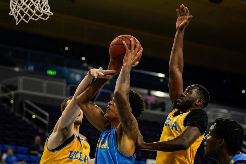 UCLA's Shareef O'Neal (22) goes is defended against during a preseason showcase at Pauley Pavilion on Wednesday in Westwood.