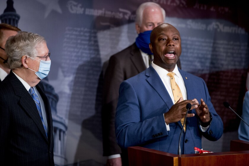 GOP Sen. Tim Scott, right, with Senate Majority Leader Mitch McConnell, speaks at a news conference Wednesday.