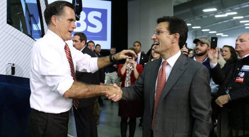 Republican presidential candidate Mitt Romney greets House Majority Leader Eric Cantor while campaigning at Meadow Event Park, in Richmond, Va.