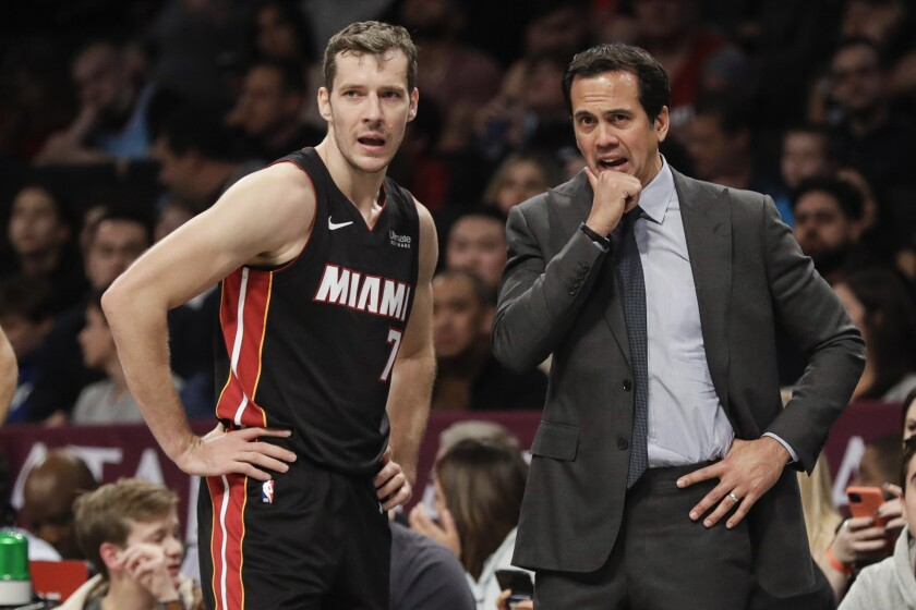 Miami Heat's Goran Dragic, left, talks to coach Erik Spoelstra during the second half of the team's NBA basketball game against the Brooklyn Nets on Friday, Jan. 10, 2020, in New York. The Nets won 117-113. (AP Photo/Frank Franklin II)