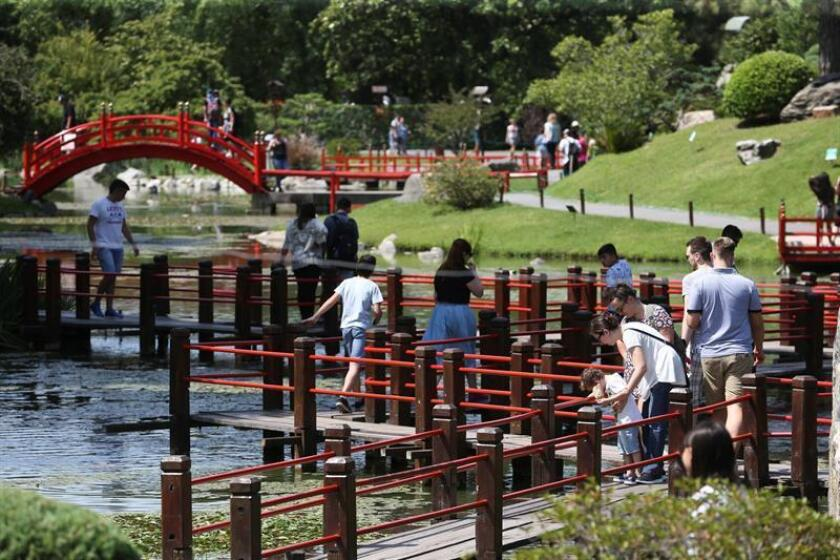 Visitors enjoy the environment and architecture on Jan. 8, 2019, at the Japanese garden in Buenos Aires, a unique park where the Argentine Japanese community has sought to preserve their traditions and culture. EFE-EPA/ Juan Ignacio Roncoroni