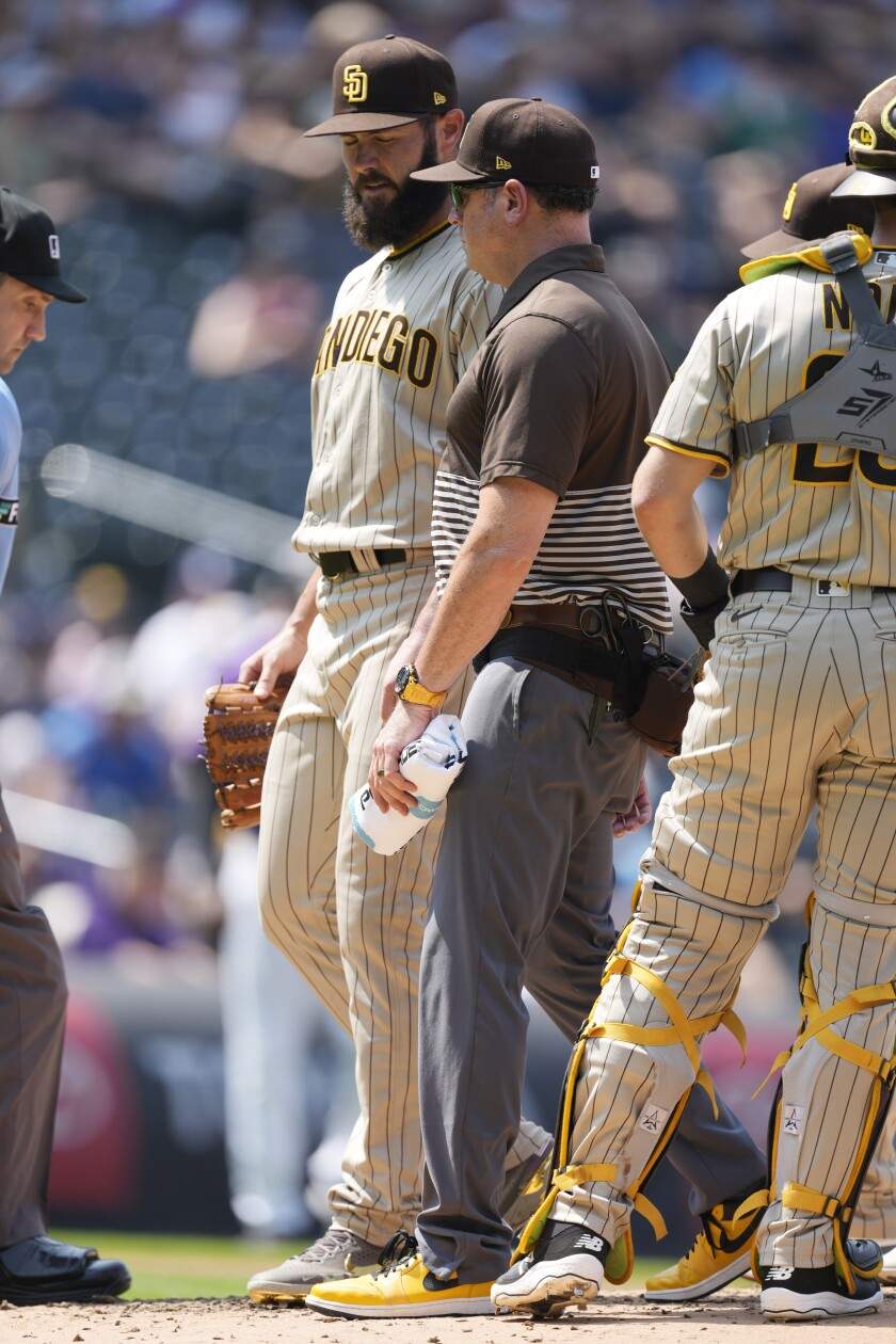 Jake Arrietta confers with Padres head athletic trainer Mark Rogow