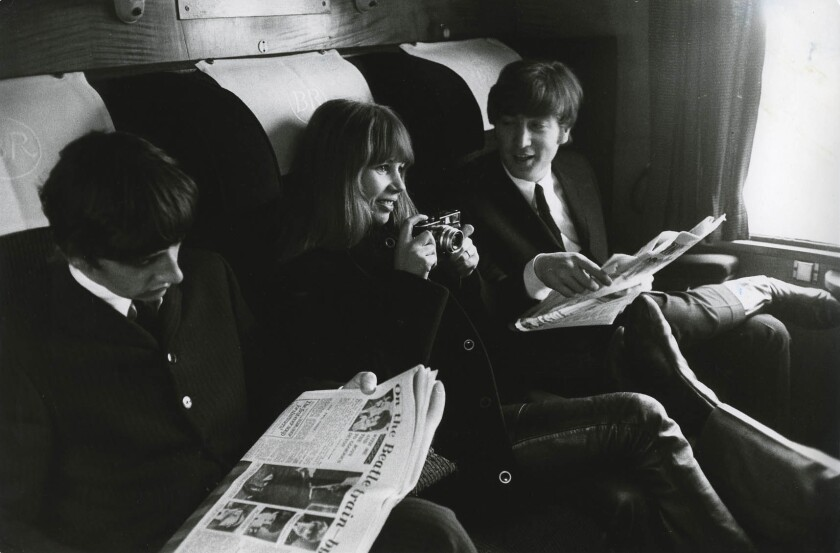 "From left, Ringo Starr, Astrid Kirchherr and John Lennon on a train during the filming of ""A Hard Day's Night."""