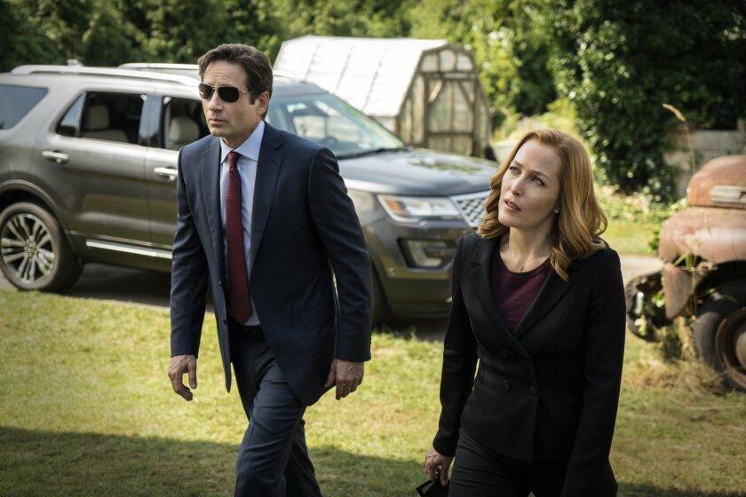 "David Duchovny, left, as Fox Mulder, with Gillian Anderson as Dana Scully, got his start on the Fox drama ""X-Files."" (Ed Araquel/FOX via AP)"