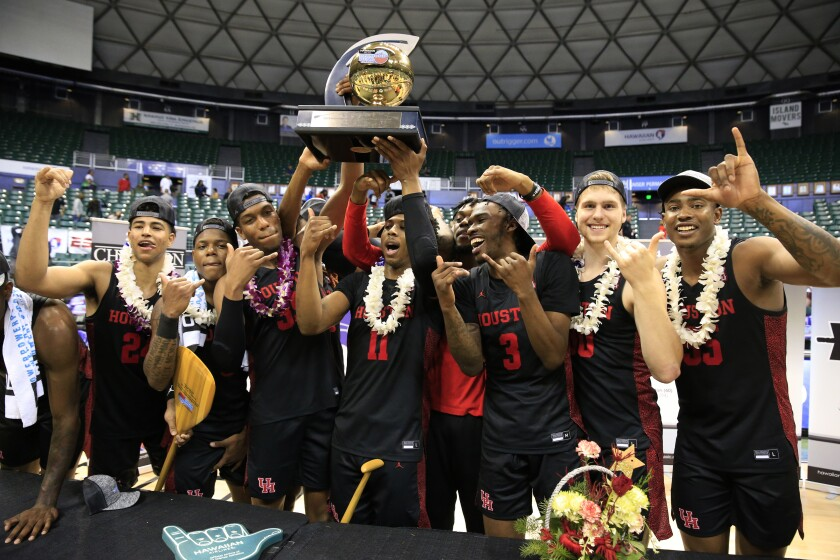 Houston players celebrate after defeating Washington to win the Diamond Head Classic in Honolulu on Dec. 25, 2019.