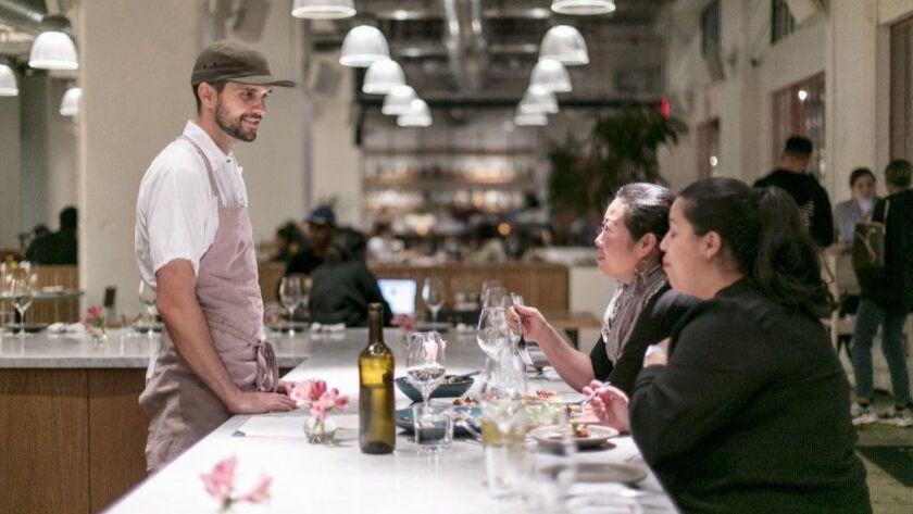 LOS ANGELES, CALIFORNIA - May 22, 2019: (L) Tartine Bianco Chef de Cuisine Camden Hershberger visit