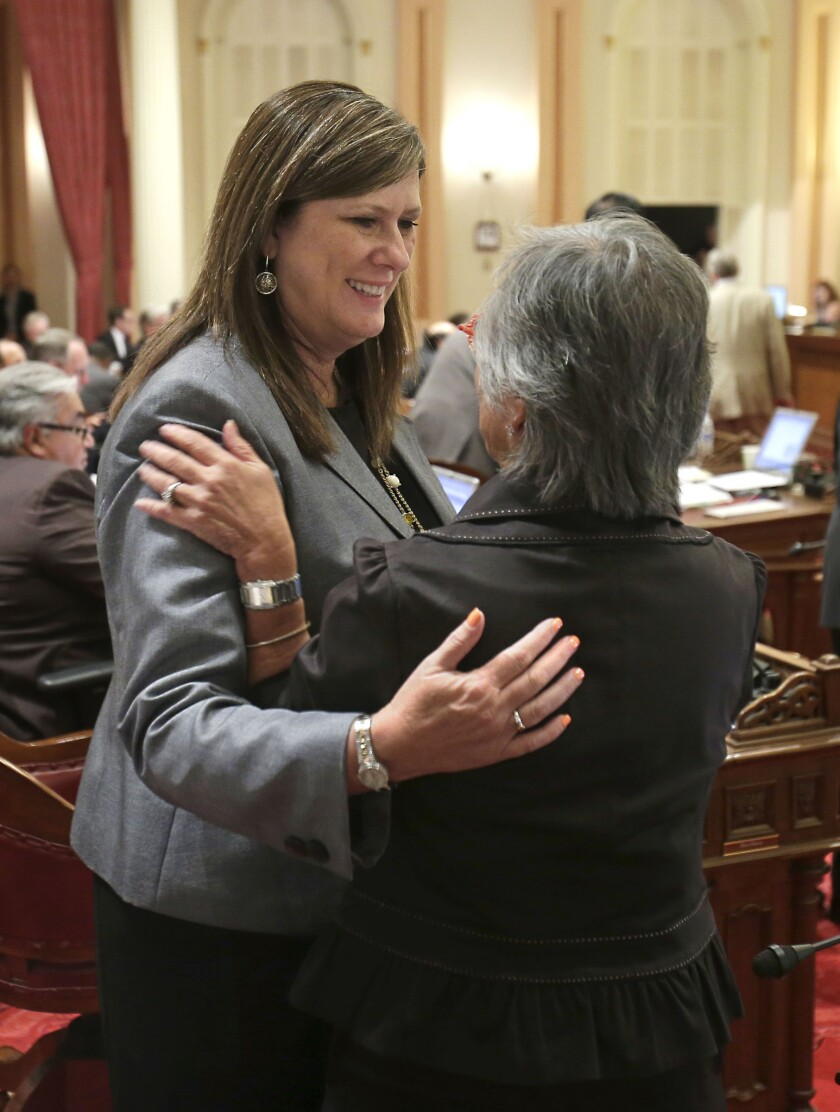 Assemblywoman Susan Bonilla (D-Concord), left, hugs Sen. Carol Liu (D-La Canada Flintridge) after the Senate approved Bonilla's bill to overhaul student testing. The Assembly passed the bill Wednesday.