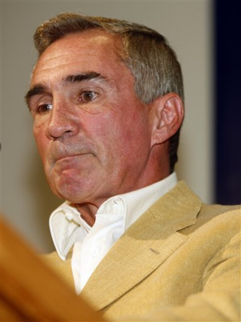 Mike Shanahan bites his lower lip as he battles with emotions while talking about his dismissal as head coach of the Denver Broncos football team during a news conference at the team's headquarters in Denver on Wednesday, Dec. 31, 2008. (AP Photo/David Zalubowski)