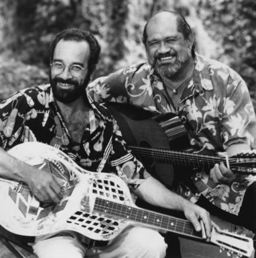 Bob Brozman, left, is shown with musician Cyril Pahinui. In recent years, Brozman traveled extensively, performing in Europe, Asia, the Americas and the South Pacific.