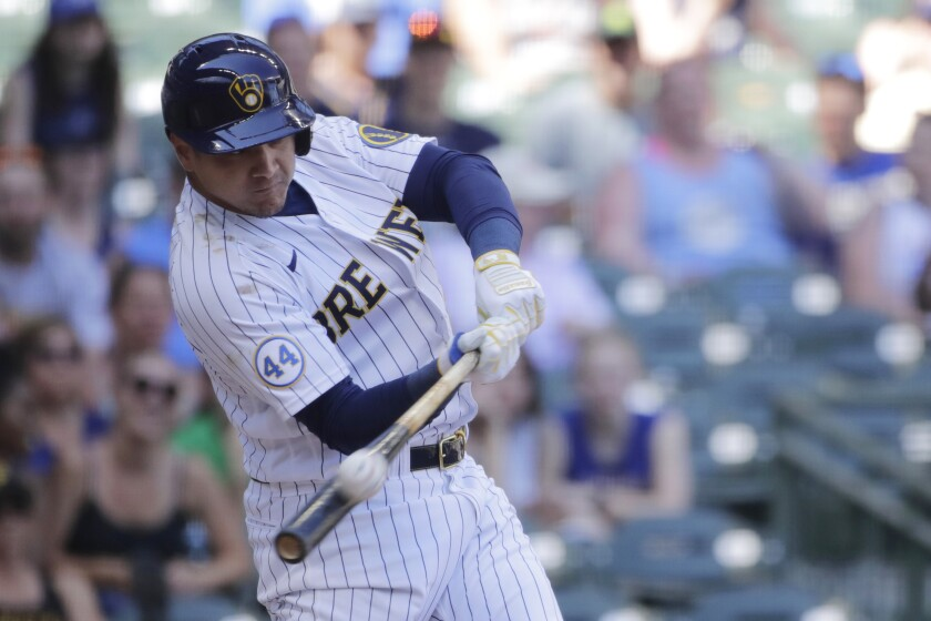 Milwaukee Brewers' Avisail Garcia hits a two-run home run during the sixth inning of a baseball game against the Pittsburgh Pirates Sunday, June 13, 2021, in Milwaukee. (AP Photo/Aaron Gash)