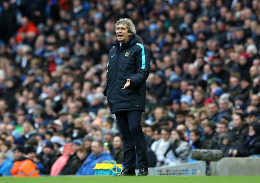Manchester City manager Manuel Pellegrini stands on the touchline during the English Premier League soccer match at the Etihad Stadium, Manchester. England, Saturday Feb. 6, 2016. (Martin Rickett / PA via AP) UNITED KINGDOM OUT - NO SALES - NO ARCHIVES
