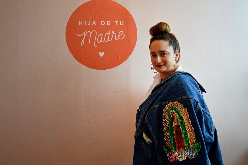 Patty Delgado, 27, is founder of Hija de tu Madre, a Los Angeles company that started when she sewed a patch bearing the revered image of the Virgin of Guadalupe, plus sequins, onto a denim jacket.